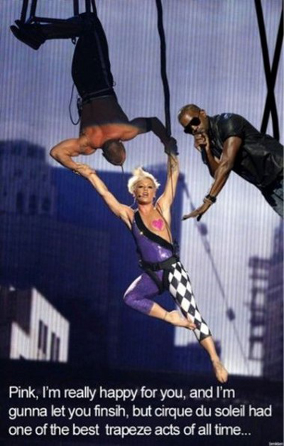 Kanye West interrupts Pink during a trapeze act